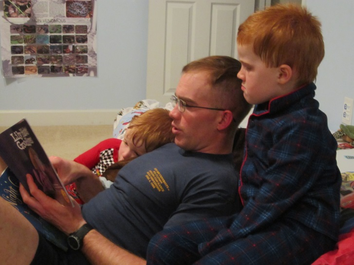 Major Mike reads to sons
